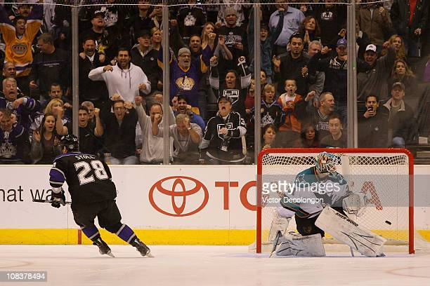 Jarret Stoll of the Los Angeles Kings scores a goal during the overtime shootout against Antti Niemi of the San Jose Sharks at Staples Center on...