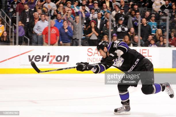 Jarret Stoll of the Los Angeles Kings shoots to score the game winning goal in a 32 shoot out against the San Jose Sharks during the game at Staples...