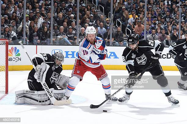 Jarret Stoll of the Los Angeles Kings skates against Derek Dorsett of the New York Rangers in Game Two of the Stanley Cup Final during the 2014...