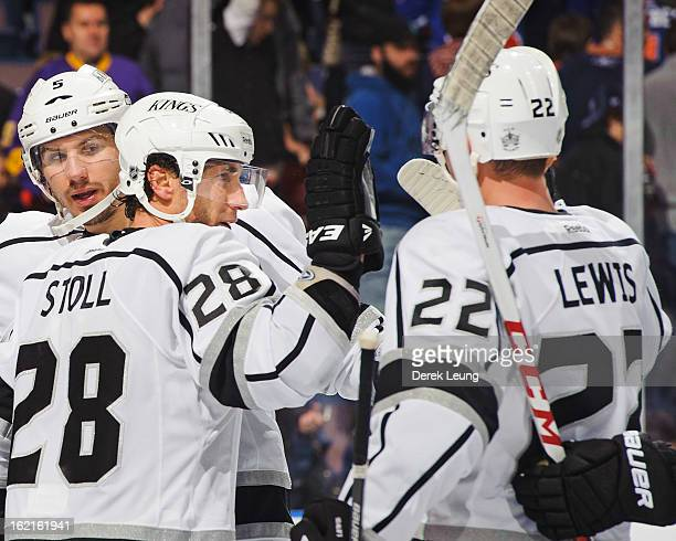 Jarret Stoll of the Los Angeles Kings who scored the winning goal against the Edmonton Oilers gets a high five after the game from Trevor Lewis after...