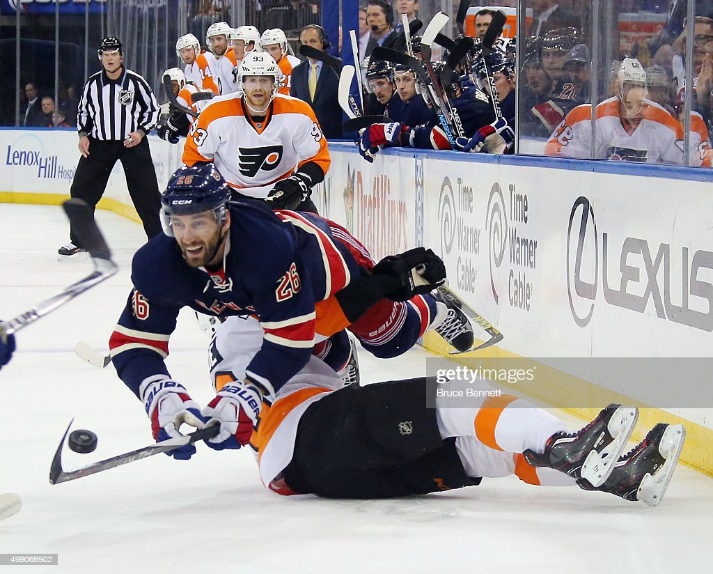 Jarret Stoll #26 of the New York Rangers flies over Chris VandeVelde #76 of the Philadelphia Flyers during the second period at Madison Square Garden on November 28, 2015 in New York City.