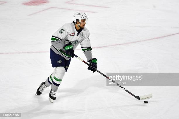 Jarret Tyszka of the Seattle Thunderbirds move the puck against the Victoria Royals in the first period at the accesso ShoWare Center on March 08...