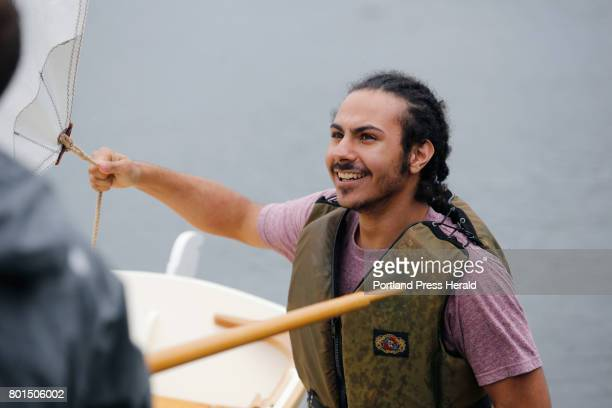Jarrett Adorno of Bronx NY a student from the Landing School launches a 13foot Catspaw dinghy in Kennebunkport The students used locally sourced wood...
