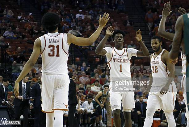 Jarrett Allen Andrew Jones and Shaquille Cleare of the Texas Longhorns high five during the game with the UAB Blazers at the Frank Erwin Center on...