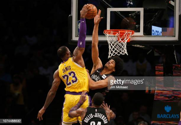 Jarrett Allen of the Brooklyn Nets blocks a dunk attempts during the first quarter against LeBron James of the Los Angeles Lakers at Barclays Center...