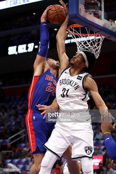 Jarrett Allen of the Brooklyn Nets blocks the dunk attempt by Blake Griffin of the Detroit Pistons in the first half during the home opener at Little...