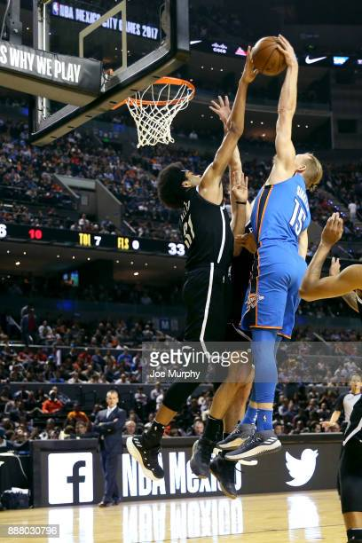 Jarrett Allen of the Brooklyn Nets blocks the shot against Kyle Singler of the Oklahoma City Thunder as part of the NBA Mexico Games 2017 on December...