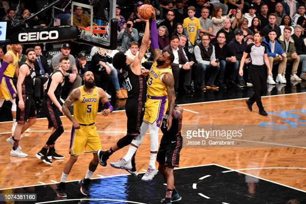 Jarrett Allen of the Brooklyn Nets blocks the shot from LeBron James of the Los Angeles Lakers on December 18 2018 at Barclays Center in Brooklyn New...