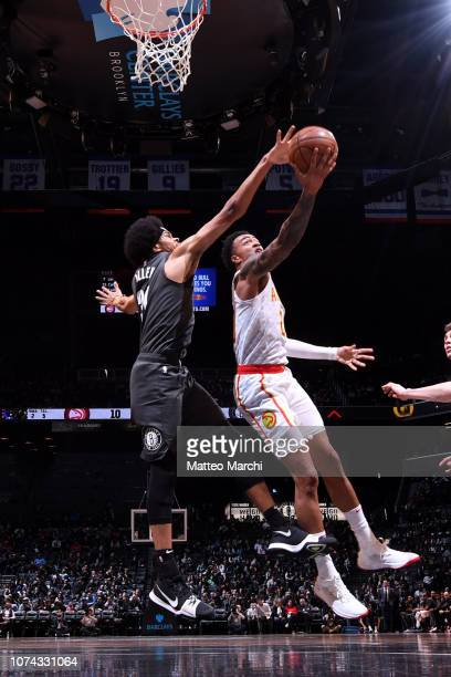 Jarrett Allen of the Brooklyn Nets contests the shot by John Collins of the Atlanta Hawks on December 16 2018 at Barclays Center in Brooklyn New York...