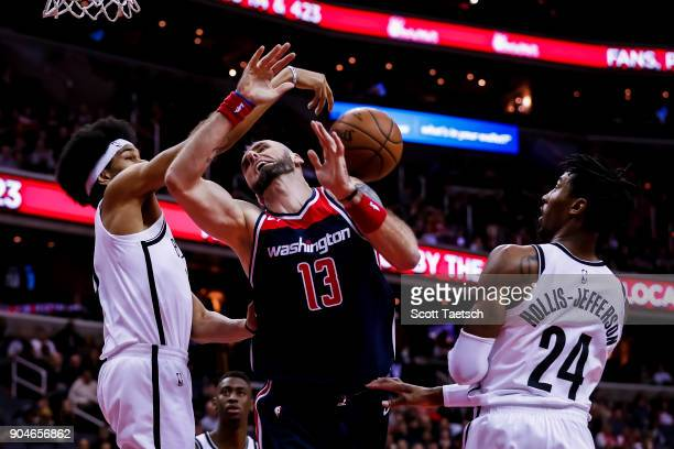 Jarrett Allen of the Brooklyn Nets defends against Marcin Gortat of the Washington Wizards during the game between the Washington Wizards and the...