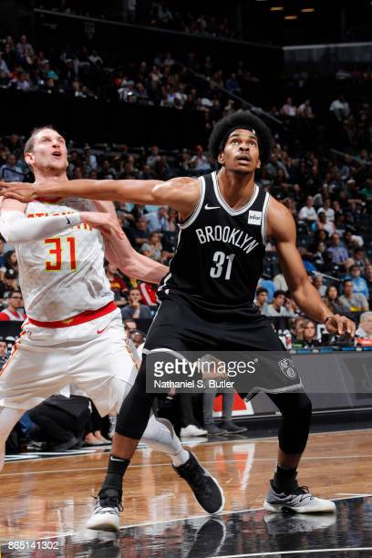 Jarrett Allen of the Brooklyn Nets defends against Mike Muscala of the Atlanta Hawks during the game between the two teams on October 22 2017 at...
