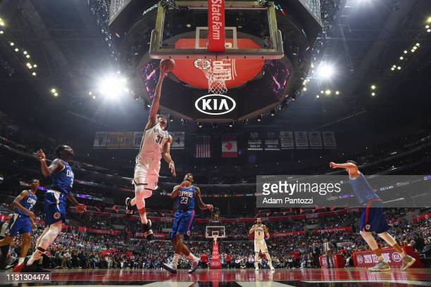 Jarrett Allen of the Brooklyn Nets drives to the basket during the game against Lou Williams of the LA Clippers on March 17 2019 at STAPLES Center in...