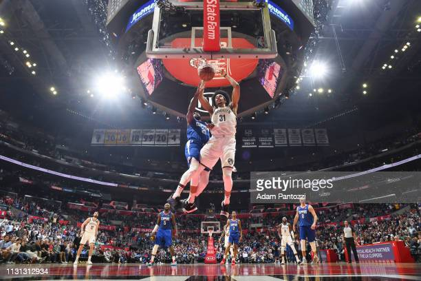 Jarrett Allen of the Brooklyn Nets drives to the basket during the game against Patrick Beverley of the LA Clippers on March 17 2019 at STAPLES...