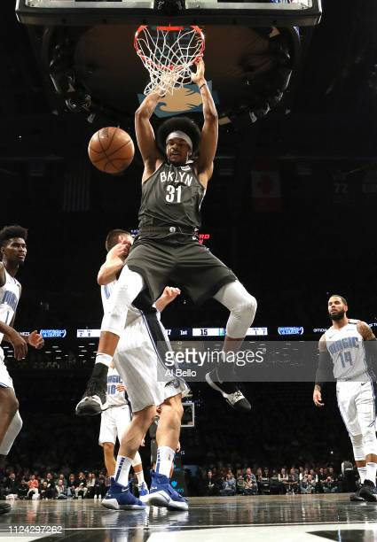 Jarrett Allen of the Brooklyn Nets dunks against Nikola Vucevic of the Orlando Magic during their game at the Barclays Center on January 23 2019 in...