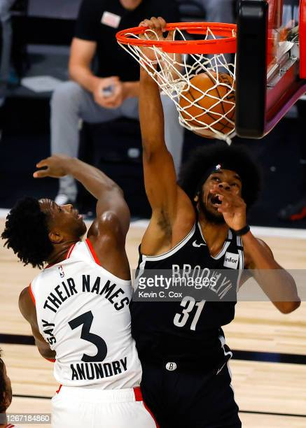 Jarrett Allen of the Brooklyn Nets dunks against OG Anunoby of the Toronto Raptors during the first quarter in Game Two of the Eastern Conference...