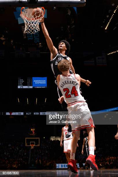 Jarrett Allen of the Brooklyn Nets dunks the ball against Lauri Markkanen of the Chicago Bulls on February 262018 at Barclays Center in Brooklyn New...