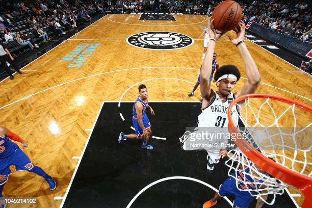 Jarrett Allen of the Brooklyn Nets dunks the ball against the New York Knicks during a preseason game on October 3 2018 at Barclays Center in...