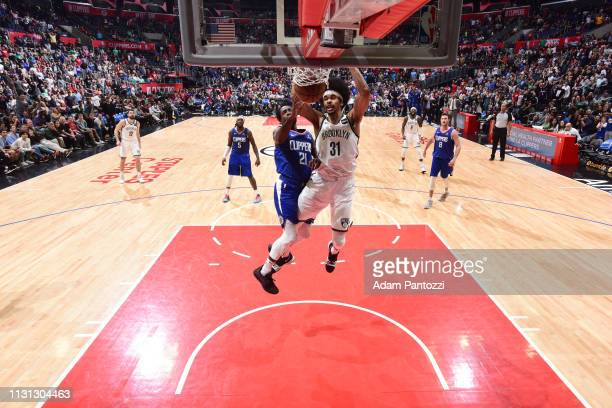Jarrett Allen of the Brooklyn Nets dunks the ball during the game against Patrick Beverley of the LA Clippers on March 17 2019 at STAPLES Center in...