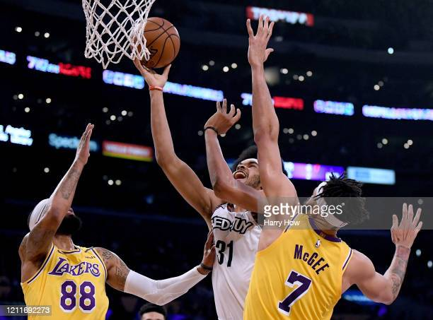 Jarrett Allen of the Brooklyn Nets gets fouled on his shot by JaVale McGee of the Los Angeles Lakers with Markieff Morris during the first half at...