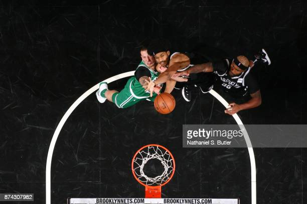 Jarrett Allen of the Brooklyn Nets goes up for a rebound against Daniel Theis of the Boston Celtics on November 14 2017 at Barclays Center in...