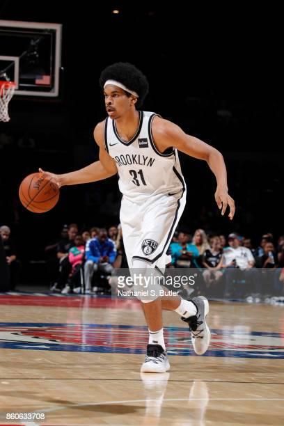 Jarrett Allen of the Brooklyn Nets handles the ball against the Philadelphia 76ers on October 11 2017 at Nassau Veterans Memorial Coliseum in...