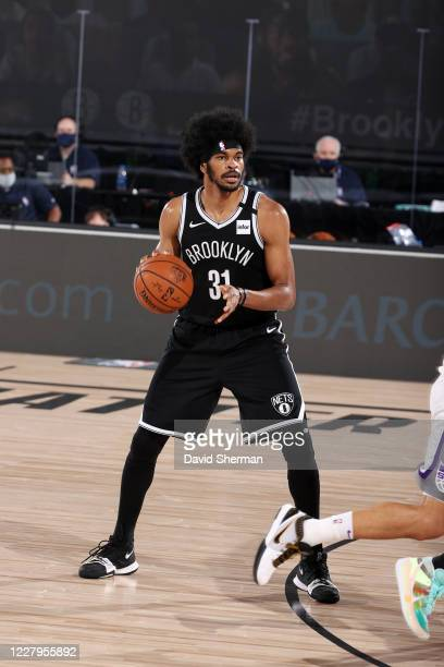 Jarrett Allen of the Brooklyn Nets handles the ball during the game against the Sacramento Kings during a game on August 7, 2020 at The Arena at ESPN...
