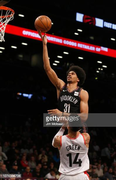 Jarrett Allen of the Brooklyn Nets in action against Danny Green of the Toronto Raptors at Barclays Center on December 7 2018 in the Brooklyn borough...