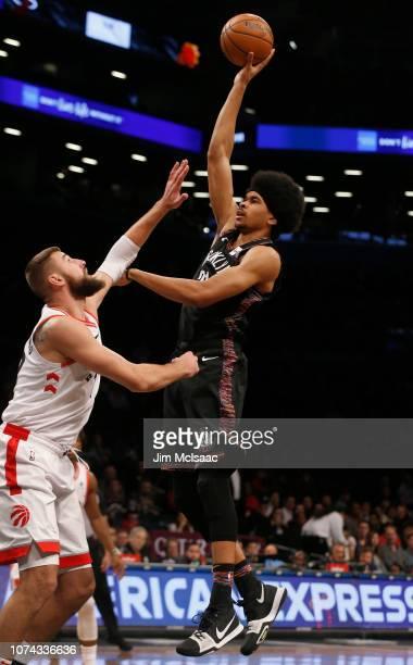Jarrett Allen of the Brooklyn Nets in action against Jonas Valanciunas of the Toronto Raptors at Barclays Center on December 7 2018 in the Brooklyn...