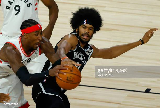Jarrett Allen of the Brooklyn Nets is called for a loose ball foul against Rondae Hollis-Jefferson of the Toronto Raptors goes during the second...