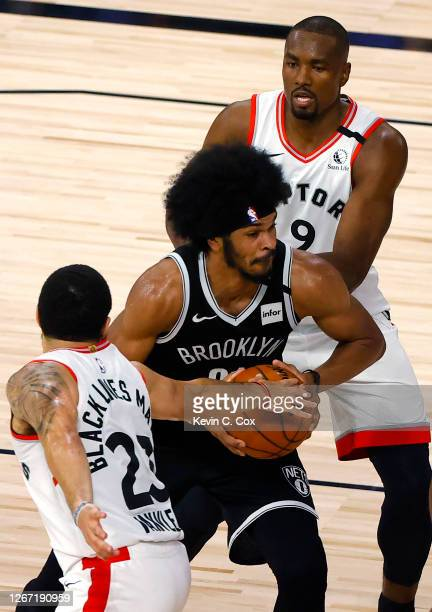 Jarrett Allen of the Brooklyn Nets is defended by Fred VanVleet and Serge Ibaka of the Toronto Raptors during the second quarter in Game Two of the...
