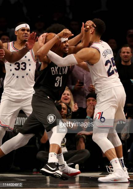 Jarrett Allen of the Brooklyn Nets is surrounded by Tobias Harris and Ben Simmons of the Philadelphia 76ers in the final seconds of the game at...