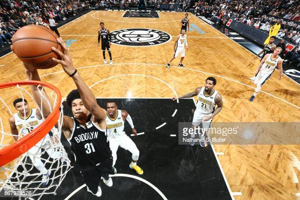 Jarrett Allen of the Brooklyn Nets shoots the ball against the Denver Nuggets on October 29, 2017 at Barclays Center in Brooklyn, New York. NOTE TO...