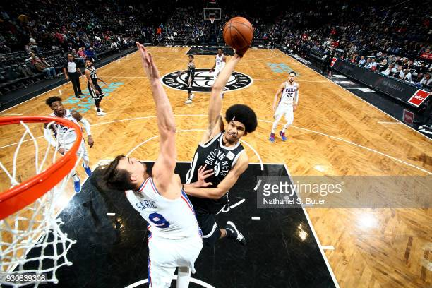 Jarrett Allen of the Brooklyn Nets shoots the ball during the game against the Philadelphia 76ers on March 11 2018 at Barclays Center in Brooklyn New...