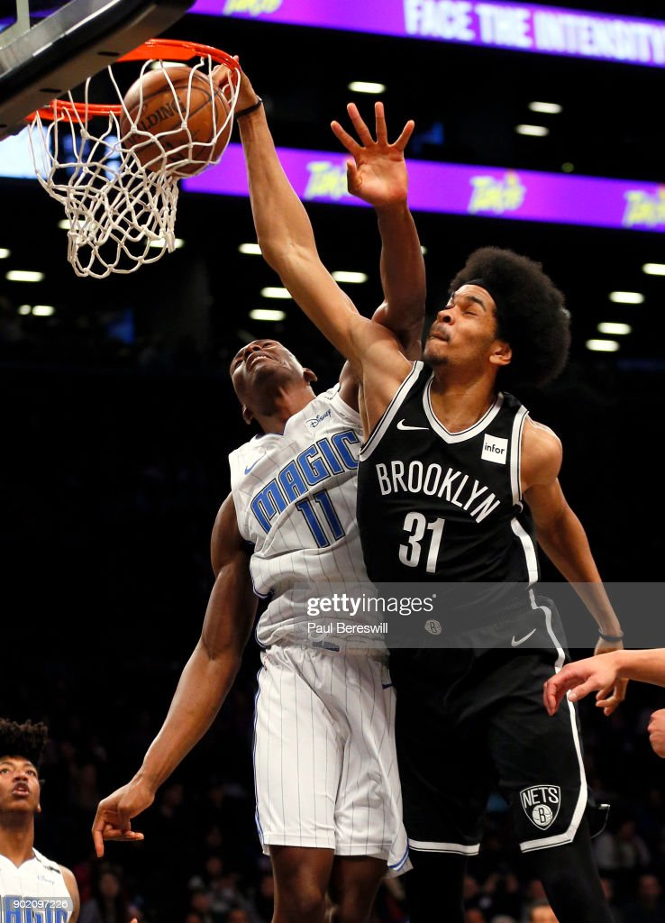 Jarrett Allen #31 of the Brooklyn Nets stuffs for two points in front of Bismack Biyombo #11 of the Orlando Magic in an NBA basketball game on January 1, 2018 at Barclays Center in the Brooklyn borough of New York City. Nets won 98-95.