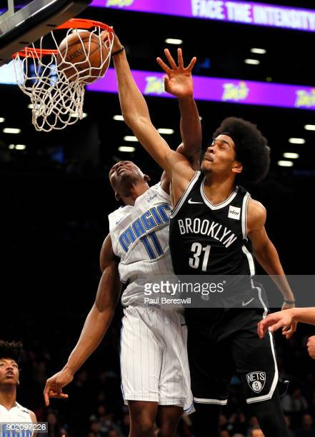 Jarrett Allen of the Brooklyn Nets stuffs for two points in front of Bismack Biyombo of the Orlando Magic in an NBA basketball game on January 1 2018...