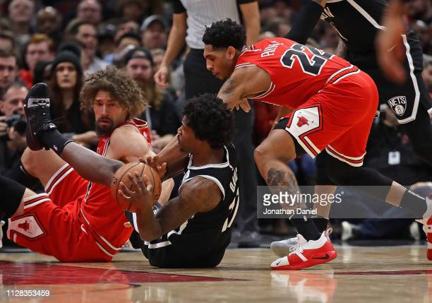 Jarrett Allen of the Brooklyn Nets tries to control the ball on the floor against Cameron Payne and Robin Lopez of the Chicago Bulls at the United...