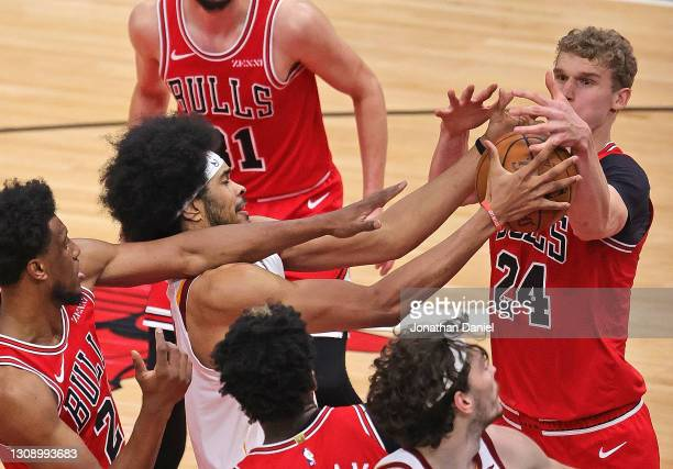 Jarrett Allen of the Cleveland Cavaliers battles for a rebound with Lauri Markkanen of the Chicago Bulls at the United Center on March 24, 2021 in...