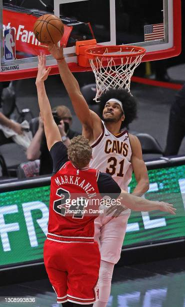 Jarrett Allen of the Cleveland Cavaliers blocks a shot by Lauri Markkanen of the Chicago Bulls at the United Center on March 24, 2021 in Chicago,...