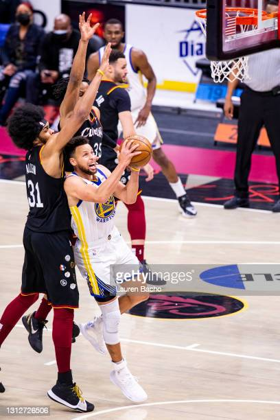 Jarrett Allen of the Cleveland Cavaliers blocks a shot by Stephen Curry of the Golden State Warriors during the third quarter at Rocket Mortgage...