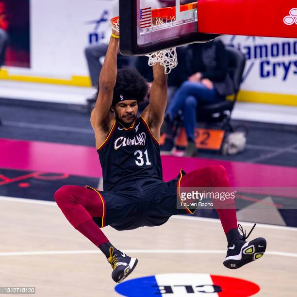 Jarrett Allen of the Cleveland Cavaliers dangles on the rim after dunking the ball in the first half against the Golden State Warriors at Rocket...