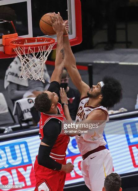 Jarrett Allen of the Cleveland Cavaliers dunks over Daniel Gafford of the Chicago Bulls at the United Center on March 24, 2021 in Chicago, Illinois....