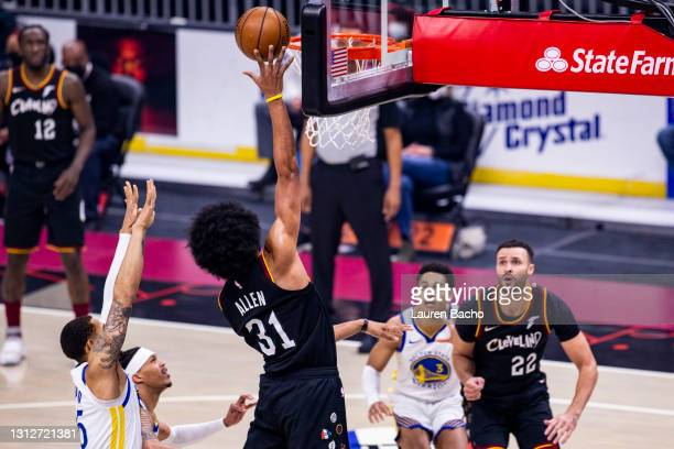 Jarrett Allen of the Cleveland Cavaliers goes in for a layup during the first quarter against the Golden State Warriors at Rocket Mortgage Fieldhouse...