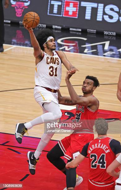 Jarrett Allen of the Cleveland Cavaliers goes up for a shot over Wendell Carter Jr. #34 of the Chicago Bulls at the United Center on March 24, 2021...