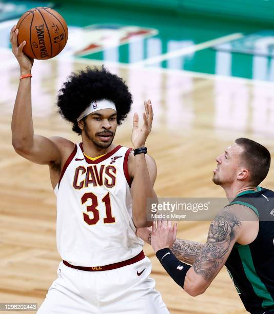 Jarrett Allen of the Cleveland Cavaliers looks to pass over Daniel Theis of the Boston Celtics at TD Garden on January 24, 2021 in Boston,...