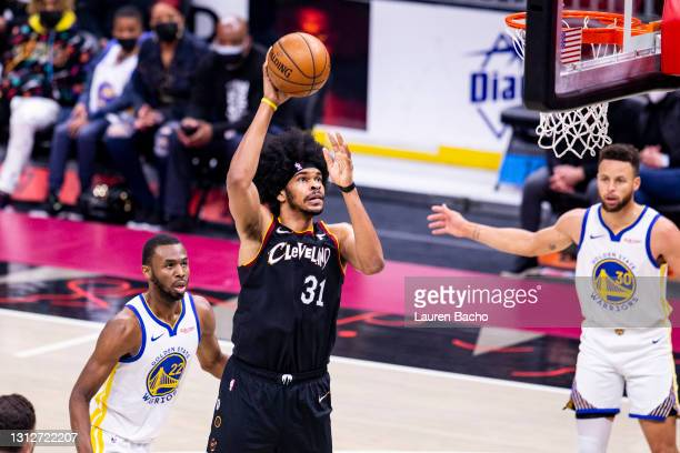 Jarrett Allen of the Cleveland Cavaliers shoots the ball against the Golden State Warriors during the second quarter at Rocket Mortgage Fieldhouse on...