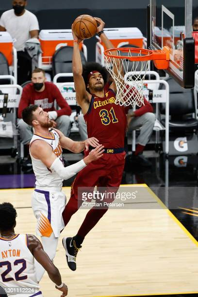 Jarrett Allen of the Cleveland Cavaliers slam dunks the ball past Frank Kaminsky of the Phoenix Suns during the first half of the NBA game at Phoenix...