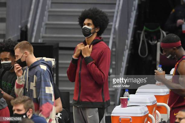 Jarrett Allen of the Cleveland Cavaliers watches his new team from the bench during the second half against the New York Knicks at Rocket Mortgage...