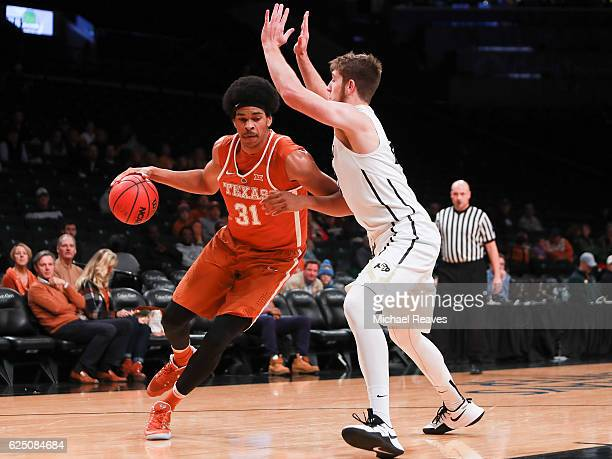 Jarrett Allen of the Texas Longhorns drives to the basket on Lucas Siewert of the Colorado Buffaloes in the first half during the consolation game of...