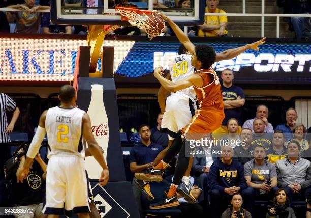 Jarrett Allen of the Texas Longhorns dunks against Sagaba Konate of the West Virginia Mountaineers at the WVU Coliseum on February 20 2017 in...