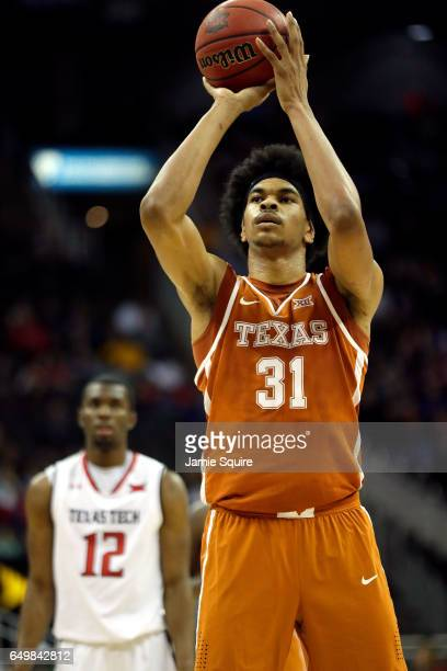 Jarrett Allen of the Texas Longhorns shoots a free throw during the first round game of the Big 12 Basketball Tournament against the Texas Tech Red...